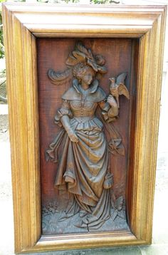 carved woman panel
