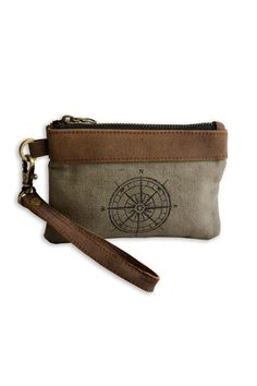 """This practicalwristlet features a blackinterior with a brown leather divided credit card holder. Top brass zip and hardware. Leather wrist band and trim. Perfect to hold your cell phone money cards and keys!  Dimensions:6"""" x 4""""  Compass Wristlet by Pine Creek. Bags - Wallets & Wristlets Tampa Florida"""