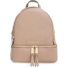 MICHAEL Michael Kors 'Small Rhea Zip' Leather Backpack ($298) ❤ liked on Polyvore featuring bags, backpacks, bolsas, dark dune, zip backpack, pocket backpack, real leather backpack, pocket bag and leather rucksack