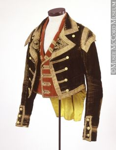 A coachman's jacket from mid-century (Victoria's century, that  is.) Servants' uniforms in affluent households often imitated styles that had been in fashion for non-working folk decades before; hence, mid-Victorian gear for footmen and coachmen had an eighteenth-century look.