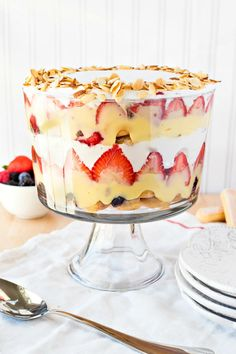 This traditional English trifle is a layered dessert made with ladyfingers soaked in sherry, fresh berries, vanilla pudding, and fresh whipped cream. The combination of these flavors and textures will blow you away! Fruit Trifle, Berry Trifle, Trifle Desserts, Berry Cake, Delicious Desserts, Dessert Recipes, Trifle Cake, Crumble Pie, Cinnamon Crumble
