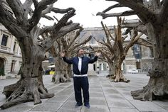 Chinese artist Ai Weiwei poses for photographers
