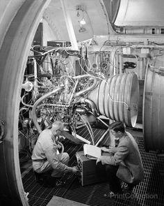 Engineers Working on Pratt and Whitney Rocket Engine