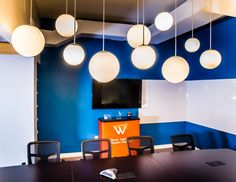 design office remodel, globe light fixtures  #commercial #buissness #design #interiordesign #conference #conferenceroom #hhi #henriettaheisler #interiordesign #remodel #lights #chandiliers #hangingpendant #blue #modern #white #table #chairs #meetingroom #coveceiling #ceiling
