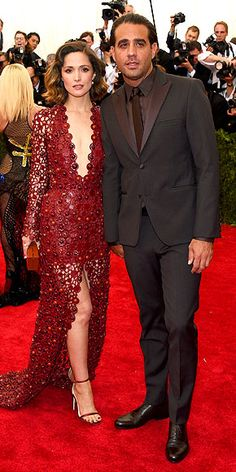 The Most Jaw-Dropping Dresses at the 2015 Met Gala | ROSE BYRNE AND BOBBY CANNAVALE  | Both in Calvin Klein Collection: Rose in a plunging maroon gown with thigh-high slit skirt and polished accessories (all by the brand) and boyfriend Bobby wearing a dark suit.
