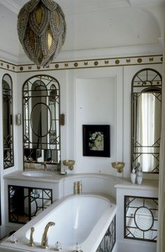 Room of the Day ~ drop dead gorgeous bath, love bud lighting fixture, mirrors, gilt trim -everything - oozing old world french 2.23.2014
