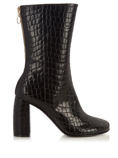 Stella McCartney's black ankle boots are crafted from ethically minded faux-leather with a crocodile-effect imprint. They're shaped with a streamlined almond toe and a curved block heel, and rise to hit just beneath the calf – ideal for balancing midi skirts and cropped trousers. Try them with head-to-toe knitwear for an on-brand result.