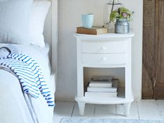 Simple. Elegant. And a bit of all white! The secret to this bedside is brushing on a pot of seriously nice chalky paint then scuffing up the edges.