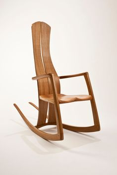 The central feature of this chair is the long curved back rest which is made from beautifully figured quarter sawn Oak. These tapered laminations have book-matched faces and provide a gentle spring when lent against, with a space down the middle allowing room for the spine. I used pegged bridle joints for the framework which are very strong and also visible, giving the chair a real feeling of strength whilst remaining light and elegant. The hand-carved solid elm seat joins all these elements... Steam Bending Wood, How To Bend Wood, Black Grout, Real Wood, Rocking Chair, Chair Design, Hand Carved, Hardwood, Wood