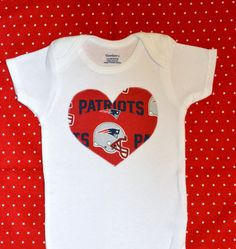 A personal favorite from my Etsy shop https://www.etsy.com/listing/466991294/new-england-patriots-heart-onesie