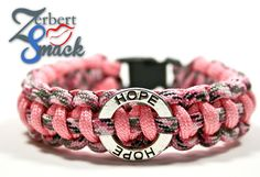 """Support Breast Cancer Awareness with this Paracord Survival Bracelet. This is a 100% Custom, handmade paracord bracelet with a round disc """"Hope"""" charm and a 3/8 inch side release buckle."""