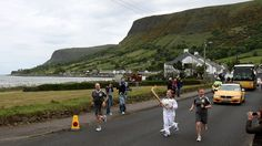 Olympic Flame on the Torch Relay journey between Ballygalley and Glenariff.