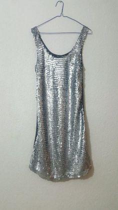 2ae2fa7919a5 Vestido plateado con lentejuelas.. Vestidos de fiesta Plateados de la marca  Sin Marca. Nuevos con etiqueta. A la venta en GoTrendier