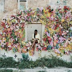 Pose like a true Mother Nature bride with this epic multicolored floral display at your reception!