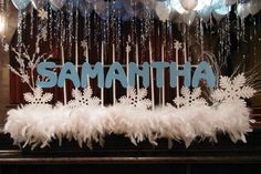 Winter Themed Candle Lighting Display with White Feathers