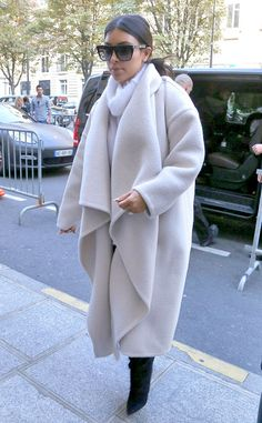 We HAVE to have Kim Kardashian's white wooly coat for winter!
