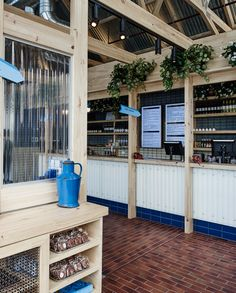 The fitout of the new Jimmy Grants restaurant by George Calombaris in Ringwood takes inspiration from the quintessential Australian back shed. Wood Facade, Greek Restaurants, Counter Design, Café Bar, Industrial Restaurant, Hall Design, Eclectic Design, Wood Interiors, Commercial Interior Design