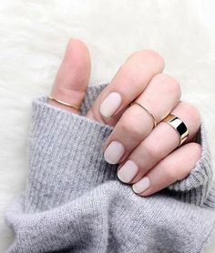 Nude polish and pretty gold rings.