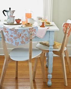 Bring sprightly designs to inexpensive chairs by covering the backs with paper, in either a single bold pattern or several coordinating ones.