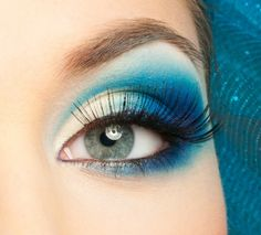 bright blue makeup looks great as a peacock look for Halloween