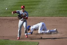 Second baseman Kolten Wong throws to first after forcing out David DeJesus of the Chicago Cubs at second base on a grounder off the bat of Junior Lake (not pictured) during the fifth inning.. Cards lost the game 7-0.  8-16-13