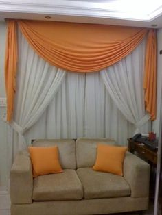 Valence in accent color over neutral drapes