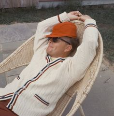 1965– Author Truman Capote relaxes in a wicker chair outside his Long Island home in the Hamptons. –Image by © Condeˆ Nast Archive/Corbis