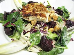 GOAT CHEESE SALAD - The scents of Provence waft from this plate of mixed greens and diced beets, Granny Smith apple slices and candied hazelnuts all tossed in a Hazelnut Vinaigrette and crowned with a warm nut-encrusted goat cheese medallion.