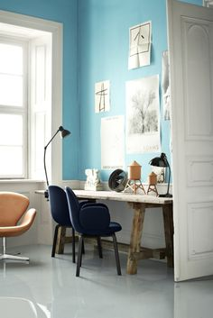 17 studies and studios to inspire your home office: A brightly coloured wall and statement chairs (these are the 'Sammen' chairs by Jaime Hayon, available from Cult) will banish any Monday blues.