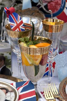 Pimm's Cup Cocktails in gold rimmed crystal goblets with a touch of Union Jack...very pretty and elegant.