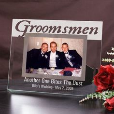 """Engraved Groomsmen Glass Picture Frames. Give your Best Man, Groomsmen & Ring Bearer a cherished keepsake and thank you gift when you present this handsome, Personalized Groomsmen Frame. This groomsman gift is the perfect way to show your wedding party how much they mean to you, being part of your big day. Our Personalized Groomsmen Picture Frame measures 9"""" x 7"""" and holds a 3½"""" x 5"""" or 4"""" x 6"""" photo. Easel back allows for desk"""