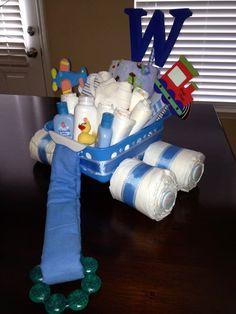 Way easier then a diaper cake! Baby Shower Diapers, Baby Shower Gifts, Baby Gifts, Diaper Animals, Nappy Cakes, Ideas Para Fiestas, Gift Baskets, Balloons, Pregnancy