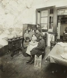 """TENEMENT HOME: """"New York: Tenement families. Early 1900s."""" Photography by Jessie Tarbox Beals (1870-1942)."""