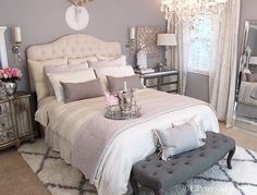 Love this bedroom. Grey walls white tufted headboard look romantic