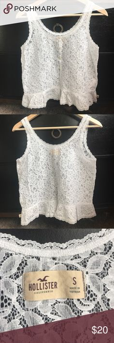 NWOT Hollister white lace ruffle hem tank NWOT Hollister white lace tank top with buttons down front and ruffle hem. Made in Vietnam, 72% cotton 28% nylon. Hollister Tops Tank Tops