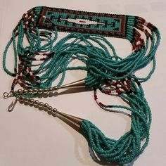 """Native American Sterling Silver Seed Bead Necklace C.1970's Beautiful in detail, in pristine condition. All seed beads are intact, beautiful burgundy red, turquoise, brown, black, and white. 24"""" long this beautiful Native American necklace is a masterpiece. Vintage Jewelry Necklaces"""