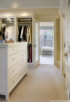 Hers closet. Maybe a little too big but I love the colors, molding and details.