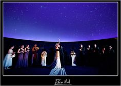 Planetarium Weddings... so weird. @Brittanny Taylor Anderson if you ever get a quirky couple without a vison... this would be sweeeeeet!