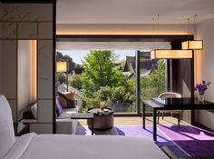 Guestroom with temple view at the Four Seasons Kyoto by HBA Design.
