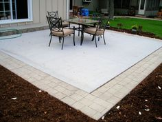 Concrete Patio with border- something similar to this would be fun for our house - spice it up a bit.