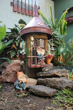 Gnome House in My Garden- A log and recycled materials as pet bottles for the door and windows and an old and rusty funnel for the roof. I hope you like it.