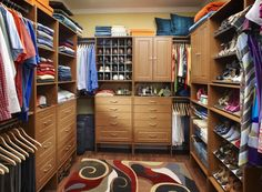 This master closet is divided down the middle for his and her peace of mind. Her side features extra shoe storage while his side makes the most of hanging rods.