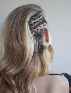 Two cornrow braids add some edge to an elegant blow out.