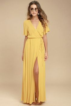 We're forever grateful we found the Much Obliged Golden Yellow Wrap Maxi Dress! Gauzy woven rayon drapes into a sultry surplice bodice framed by fluttering short sleeves. Wrapping maxi skirt secures via hidden internal ties and an adjustable waist tie.