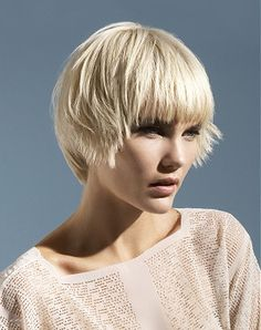 A short blonde straight colored bob hairstyle