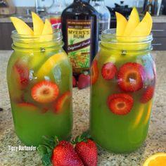 Tipsy Bartender Green Mango Mai Tai- orange slices, white rum, dark rum, mango nectar, orgeat syrup, lime juice, blue curacao, strawberry slices, mango slices