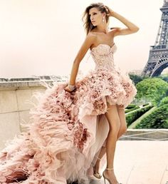 Monique Lhuillier Blush High-Low Wedding Dress with Tulle Ruffles and Feather