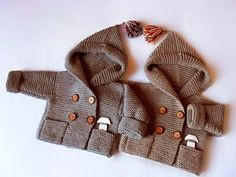 Hand knit hooded coat for baby