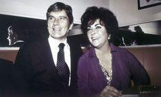 John Warner and Elizabeth Taylor in her favorite purple pantsuit by Halston. 1977