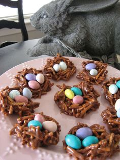 Easter Nest Treats ...so easy!  1/4 cup butter 4 1/2 cups mini marshmallows 1/4 cup creamy peanut butter 1/2 cup semisweet chocolate chips 4 cups chow mein noodles candy eggs (mini Cadbury eggs, M or jelly beans)
